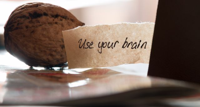Use your brain, hand lettering,  book and walnut